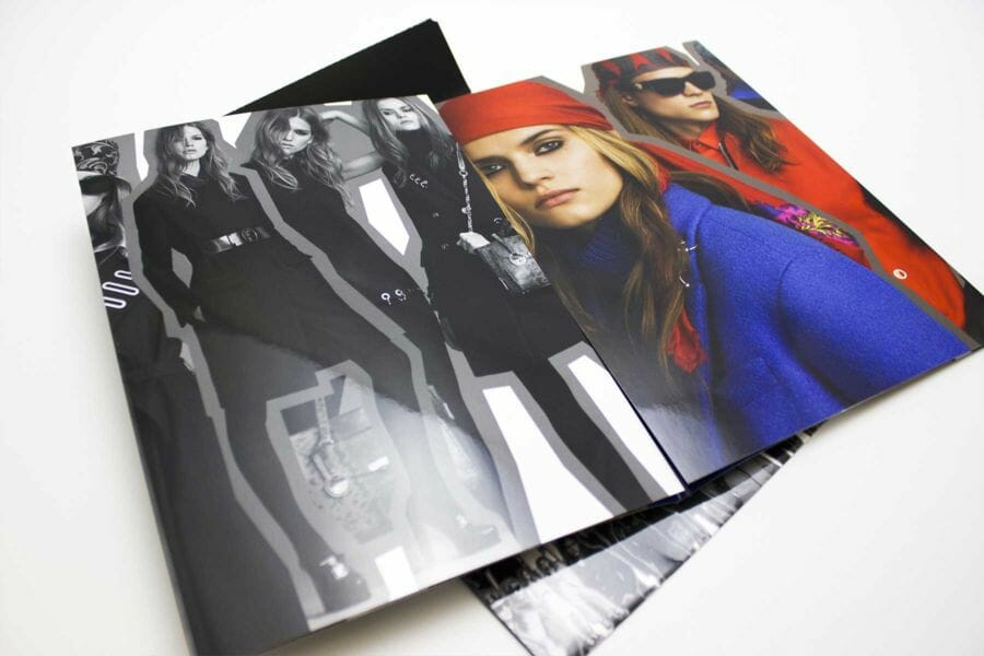 Gloss lamination - A technique in which a glossy film is applied to embellish the cover or other pages of a published project, enhancing the quality of the paper and the finished product with brighter, more brilliant colours.