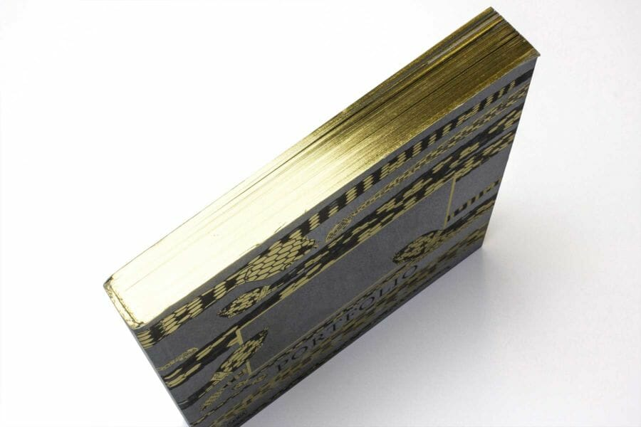 Edge gilding - A technique that allows the outer edges of a book to be coloured using traditional palettes as well as fluorescent and metallic colours.